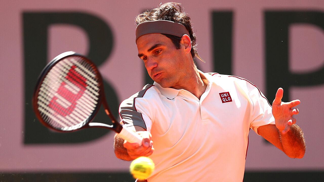 Klarer-Sieg-Federer-gl-ckt-Rasen-Auftakt